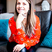 Laura Wosiak, Rebirthing Breathworker & Transformational Life Coach,   owner of Boundless Breathwork poses for a portrait in her home. (photo by Leonardo Carrizo)