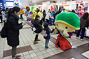 Japanese Yuru chara mascot family event with happy children