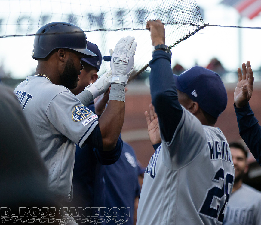 San Diego Padres' Manuel Margot, left, is congratulated by his teammates after hitting a two-run home run against the San Francisco Giants during the third inning of a baseball game, Thursday, Aug. 29, 2019, in San Francisco. (AP Photo/D. Ross Cameron)