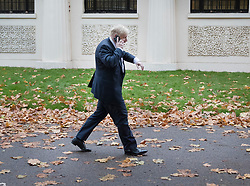 © Licensed to London News Pictures. 15/11/2017. London, UK.  Foreign Secretary Boris Johnson talks on the phone as he walks to Whitehall ahead of a meeting with Richard Ratcliffe.  Mr Ratcliffe's wife, Nazanin Zaghari-Ratcliffe, is currently serving a five-year prison sentence after being arrested at Tehran airport in April 2016 as she attempted to return home from a visit to see her family. Her sentence may be increased after Foreign Secretary Boris Johnson mistakenly said she was in Iran to train journalists. Photo credit: Peter Macdiarmid/LNP