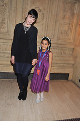 OLIVIA WILLIAMS and her daughter ESME at Cirque du Soleil's VIP night of Kooza held at the Royal Albert Hall, London on 8th January 2013.