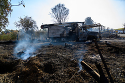 October 29, 2019, CA, USA: A smoldering vehicle sits in field alone Chalk Hill Road during the Kincade Fire in Sonoma County on Tuesday, October 29, 2019 in  (Credit Image: © Paul Kitagaki Jr./ZUMA Wire)