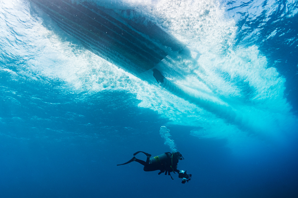 A boat drives fast over a scuba diver in the Red Sea off Marsa Alam, Egypt.