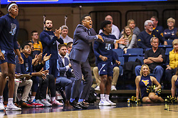 Dec 1, 2019; Morgantown, WV, USA; Rhode Island Rams head coach David Cox yells from the bench during the second half against the West Virginia Mountaineers at WVU Coliseum. Mandatory Credit: Ben Queen-USA TODAY Sports