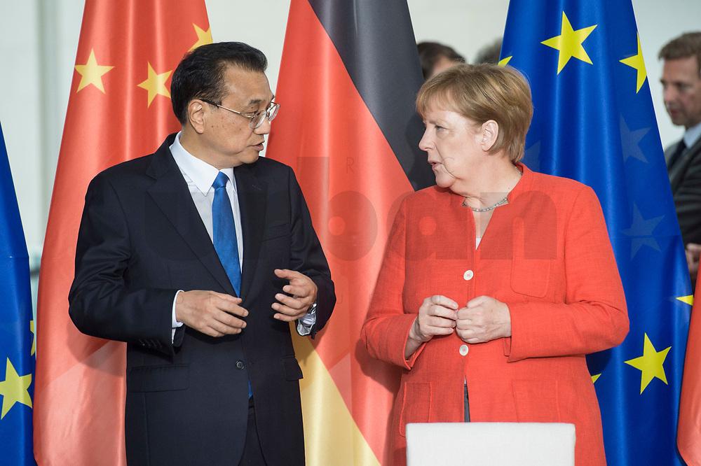 09 JUL 2018, BERLIN/GERMANY:<br /> Li Keqiang (L), Ministerpraesident der VR China, und Angela Merkel (R), CDU, Bundeskanzlerin, waehrend der Unterzeichnung von Regierungs- und Wirtschaftsabkommen im Rahmen der Deutsch-Chinesische Regierungskonsultationen, Bundeskanzleramt<br /> IMAGE: 20180709-02-007