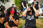 20 JULY 2020 - DES MOINES, IOWA:  Black Lives Matter protesters at a rally calling for the release of Viet Tran at the Polk County Criminal Courts building Monday. About 50 members of Des Moines Black Lives Matter protested in support of Viet Tran, one of their members who was arrested by Des Moines Police on July 1. He was arrested on charges of disseminating classified or confidential police information because during an interview with a local TV station, he held a memo from the Des Moines Police Department naming individuals police wanted to arrest on vandalism charges. He got the memo from another Black Lives Matter protester. Today's protest was timed to coincide with Tran's bond hearing, which was delayed at the last minute. He has been held without bond since his arrest.        PHOTO BY JACK KURTZ