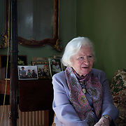 Phyllis Dorothy James, Baroness James of Holland Park, OBE, FRSA, FRSL (born 3 August 1920), commonly known as P. D. James, is an English crime writer and Conservative life peer in the House of Lords, most famous for a series of detective novels starring policeman and poet Adam Dalgliesh. She is also the author of Children of Men, which was the basis of the feature film of the same name, directed by Alfonso Cuarón. Here she is photographed at her home in London.