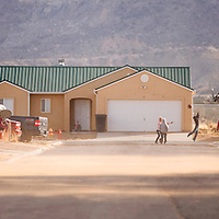 040113       Brian Leddy<br /> Children play basketball in the street of Chilchenbito Estates near Chilchenbito, Ariz. Monday afternoon. The homes were built by the now bankrupt Lodgebuilders Inc., but were finished by the Navajo Housing Authority.