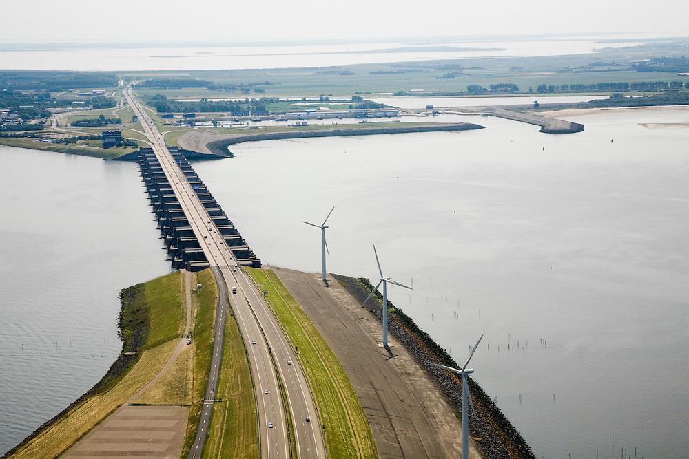 Nederland, Zuid-Holland, Goeree-Overflakkee, 04-07-2006; dam and sluices between islands Voorne-Putten and Goeree-Overflakkee; the sluices are for sluicing water coming from the rivers Rhine and Maas (Meuse) from the naturabassin (left) to the North sea (right);.Haringvlietdam met windmolens en de Haringvlietsluizen, gezien in de richting van Stellendam op Goeree-Overflakkee (met Buitenhaven, rechts); het water van de Grevelingen achter het eiland aan de horizon; de sluizen zijn spui-sluizen en zorgen er voor dat het zoete water uit het Haringvliet (links op de foto) zoals aangevoerd door Maas en Rijn geloosd kan worden; waterbeheer, getijden, brak, spuien, algen, visstand, Deltawerken, milieu, milieuproblematiek, landschap, natuur, zand, strand .luchtfoto (toeslag); aerial photo (additional fee required); .foto Siebe Swart / photo Siebe Swart