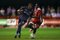 Charlton Athletic's Ezri Konsa (left) and Crawley Town's Ibrahim Meite battle for the ball