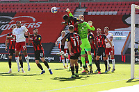 Football - 2020 / 2021 Sky Bet Championship - AFC Bournemouth vs. Middlesbrough - The Vitality Stadium<br /> <br /> Bournemouth's Asmir Begovic punches clear above Bournemouth's Jefferson Lerma during the Championship match at the Vitality Stadium (Dean Court) Bournemouth <br /> <br /> COLORSPORT/SHAUN BOGGUST