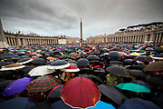 Thousands of people wait in the pouring rain for the selection of a new Pope in St. Peter's Square during the second day of conclave and the selection of the new Pope in Vatican City, March 13, 2013. The new Pope is Cardinal Jorge Mario Bergoglio of Argentina. He is the 266th leader of the Catholic Church. He will be called Pope Francis.Photograph by Todd Korol