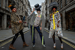 © Licensed to London News Pictures. 26/12/2020. LONDON, UK.  Models take part in a Boxing Day flashmob through St James's for designer Pierre Garroudi.  Photo credit: Stephen Chung/LNP