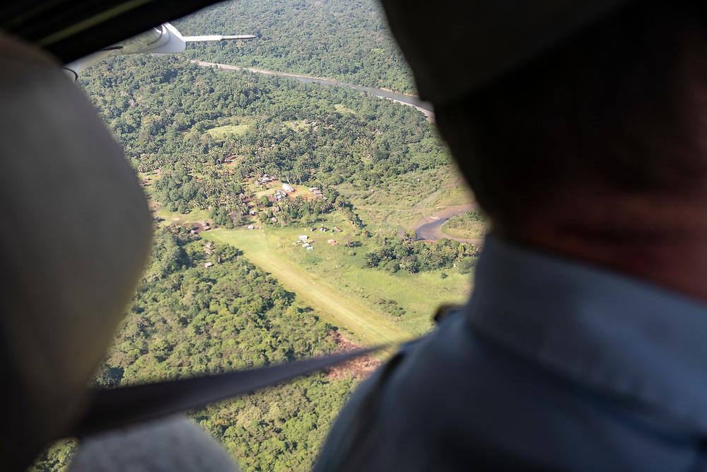 Josh Verdonck, a pilot for Ethnos360 Aviation, circles his Quest Kodiak 100 over the airstrip before landing in Likan, East Sepik Province, Papua New Guinea.<br /> <br /> (June 20, 2019)