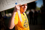 15 APRIL 2011 - PHOENIX, AZ: A Tea Party supporter at the Arizona State Capitol in Phoenix, AZ, Friday. About 500 supporters of the Tea Party movement rallied Friday at the Arizona State Capitol to mark tax day. They protested high taxes, the federal deficit, the debt limit and immigration policy. About 50 pro-immigrant protesters held a counter rally at the capitol. At least one person was arrested, and others led away by police after several shouting matches between Tea Party supporters and the immigrants rights protesters broke out.     Photo by Jack Kurtz