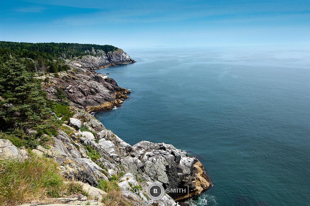 Rugged and steep rocky coastline of Monhegan Island in Maine
