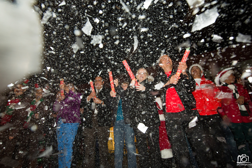 Milpitas Mayor Jose Esteves, right, and other city officials blast snow cannons during the countdown to mark the lighting of the city's Christmas Tree during the Milpitas Christmas Tree Lighting Ceremony at Milpitas City Hall, in Milpitas, California, on December 1, 2013. (Stan Olszewski/SOSKIphoto)