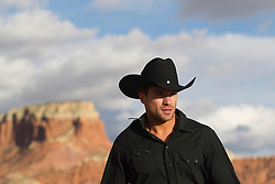 very good looking cowboy outdoors in a mountain range