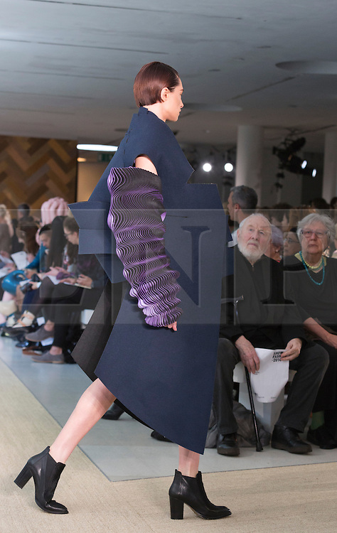 © Licensed to London News Pictures. 29/05/2014. London, England. Collection by Katherine Roberts-Wood. 30 students of the Royal College of Art's prestigious MA Fashion programme presented their final collections in  a runway show at the RCA building in Kensington. Photo credit: Bettina Strenske/LNP