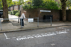 "© Licensed to London News Pictures. 16/09/2018. London, UK. Community activists spray paint ""Drug Dealer Only"" parking spaces and erect street signs to highlight increasing levels of drug dealing in the E2 postcode, known as the cheapest heroin in Europe, East London, UK. Photo credit: Ray Tang/LNP"