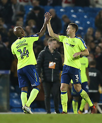 Derby County's Andre Wisdom (left) and Craig Forsyth celebrate after the final whistle