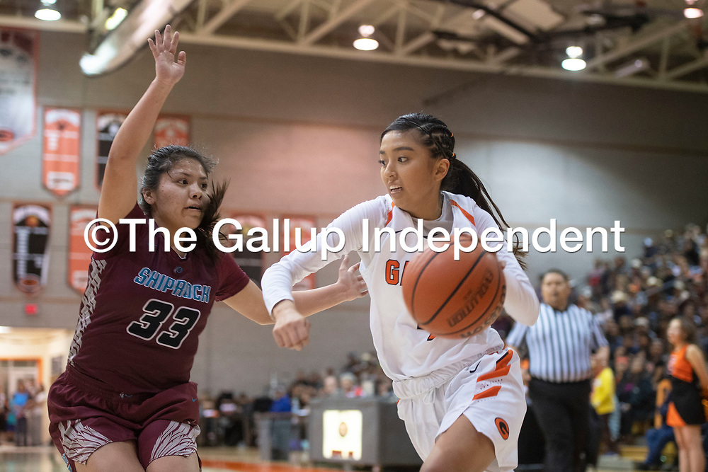 Gallup Bengal Jordan Hanley (4) drives to the basket as Shiprock Chieftain Sanaa Keeswood (33) defends in their district 1-4A championship game Saturday night at Gallup High School in Gallup. The Bengals beat the Chieftains 72-57.