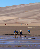 Crossing Medano Creek in the Spring to the Sand Dunes. Great Sand Dunes National Park, Southwest Colorado. Image taken with a Nikon D300 and 80-400 mm VR lens (ISO 200, 80 mm, f/8, 1/1250 sec)..