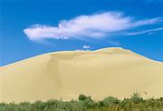 Cloud and sand dune, Great Sand Hills near Leader, Saskatchewan, Canada