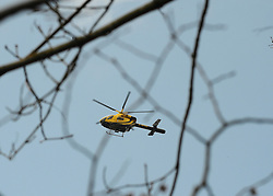 ©London News pictures. 22/03/11.  A police helicopter joined the search. Locals and friends of Sian O'Callaghan help Police in the search in Savernake Wood, Wiltshire, today. Detectives continue investigating the disappearance of office administrator Sian O'Callaghan. The 22-year-old disappeared after leaving Suju nightclub in Swindon at about 2.50am on Saturday to walk the half-mile home to the flat she shared with her boyfriend Kevin Reape. Picture Credit should read Stephen Simpson/LNP