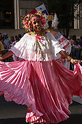 folk dancers perform in a flower parade on Central Park West in New York NY