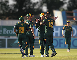 AD Russell of Notts Outlaws (R) celebrates taking the wicket of CF Hughes of Derbyshire Falcons (Not Pictured) - Mandatory by-line: Jack Phillips/JMP - 24/06/2016 - CRICKET - The 3aaa County Ground - Derby, United Kingdom - Derbyshire Falcons v Notts Outlaws - Natwest T20 Blast