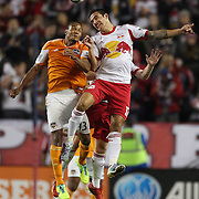 Ricardo Clark, (left), Houston Dynamo, and Tim Cahill, New York Red Bulls, challenge for a header during the New York Red Bulls V Houston Dynamo , Major League Soccer second leg of the Eastern Conference Semifinals match at Red Bull Arena, Harrison, New Jersey. USA. 6th November 2013. Photo Tim Clayton