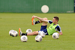 24.04.2014, Veltins Arena, Gelsenkirchen, GER, 1. FBL, Training Schalke 04, im Bild Julian Draxler ( Schalke 04 ) bei Dehnungsuebungen umringt von Baellen. // during a Trainingsession of German Bundesliga Club Schalke 04 at the Veltins Arena in Gelsenkirchen, Germany on 2014/04/24. EXPA Pictures © 2014, PhotoCredit: EXPA/ Eibner-Pressefoto/ Thienel<br /> <br /> *****ATTENTION - OUT of GER*****