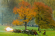 Smoke clouds th epark as the salute is fired - The King's Troop Royal Horse Artillery (KTRHA), the ceremonial saluting battery of Her Majesty's Household Division, fire a 41-gun Royal Salute in honour of His Royal Highness The Prince of Wales's 69th birthday. 71 horses pulling six First World War-era 13-pounder Field Guns came into action from in the park halfway down Constitution Hill.  Each of the guns fired blank artillery rounds at ten-second intervals. London 14 Nov 2017