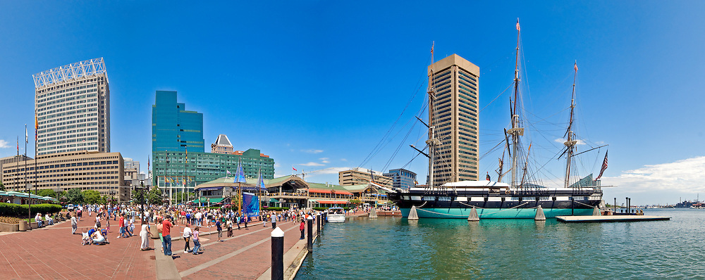 Waterfront buildings at Inner Harbor in Baltimore, Maryland, on a clear day. High resolution panorama.