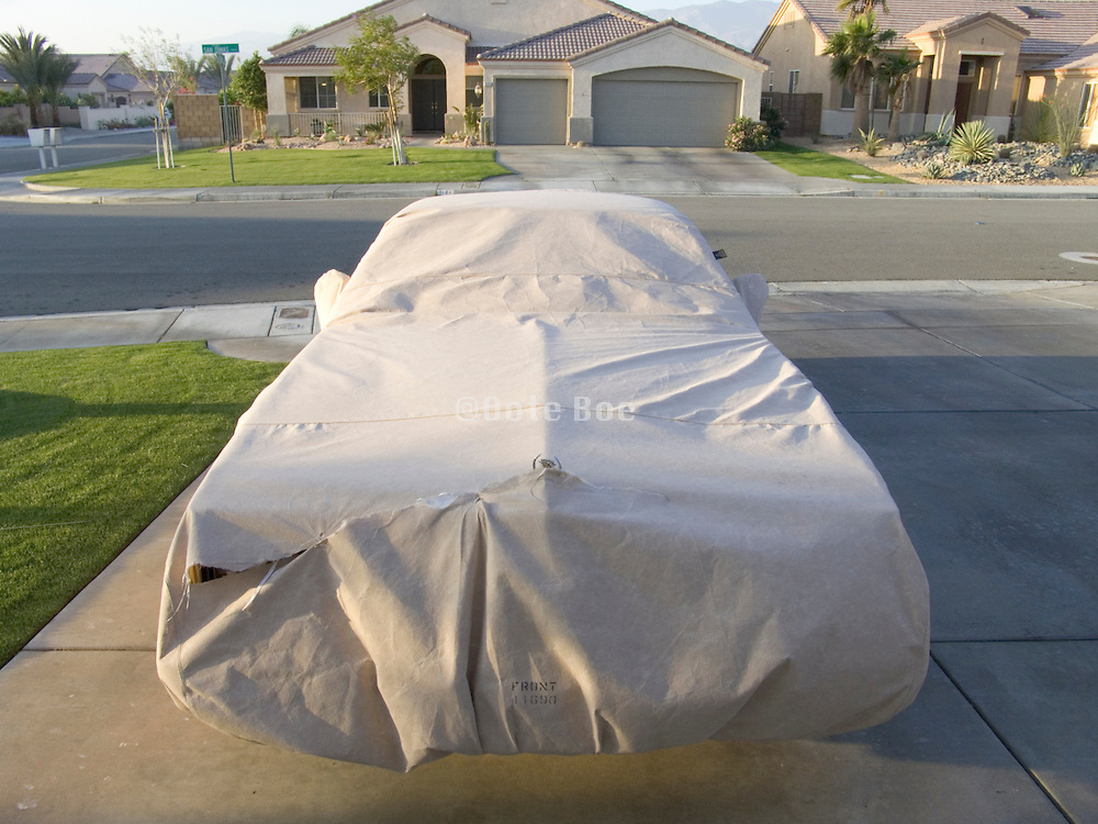 covered car parked in a driveway