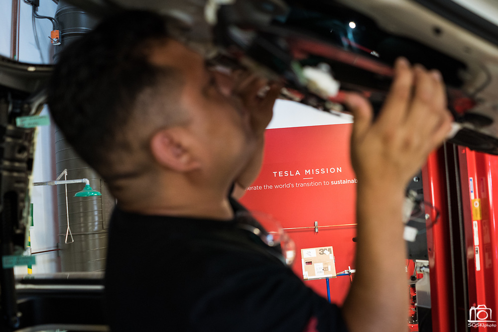 Gerard Quevedo of Perris works on a Tesla Model X door during the Tesla Start class at Evergreen Valley Community College in San Jose, California, on August 8, 2019. (Stan Olszewski for Silicon Valley Business Journal)
