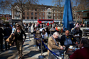 People gather at Duke of York's Square on the Kings Road, Chelsea. This is a famous affluent area where people come to parade and of course, shop.