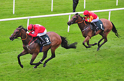 Gordon Lord Bryon ridden by Chris Hayes (left) wins the Weatherby's Ireland Greenland Stakes at the Curragh Racecourse, Dublin.