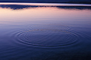 Reflection and water ripples at sunset