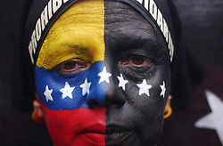 Opposition to President Hugo Chavez march in memory of all their wounded and killed countrymen on the 12 year anniversary of Chavez's failed coup attempt.  The coup attempt was the first thing that turned  Chavez into a nationally recognized figure.