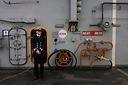 A student officer on duty on the top deck during a tour by the general public on-board the Royal Navy's aircraft carrier HMS Illustrious during a public open-day in Greenwich. Illustrious docked on the river Thames, allowing the tax-paying public to tour its decks before its forthcoming decommisioning. Navy personnel helped with the PR event over the May weekend, historically the home of Britain's naval fleet.
