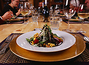 First course of salad served for dinner at Winterlake Lodge with Kirsten and Carl Dixon and Madeleine and Alan Kamman beyond, Alaska.