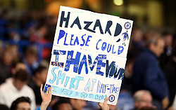 A fan holds up a sign for Chelsea's Eden Hazard's shirt before they need to go to bed