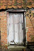 Old locked door to garden shed