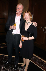TV producer MIKE HOLLINGSWORTH former husband of Anne Diamond and MISS KIMBERLEY STEWART-MOLE  at the Holders Season Barbados Comes to London night at The Four Seasons Hotel, Hamilton Place, London on 3rd February 2006.<br />