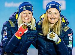 24.02.2019, Medal Plaza, Seefeld, AUT, FIS Weltmeisterschaften Ski Nordisch, Seefeld 2019, Langlauf, Damen, Teambewerb, Siegerehrung, im Bild Weltmeisterin und Goldmedaillengewinnerin Stina Nilsson, Maja Dahlqvist (SWE) // World champion and Gold medalist Stina Nilsson Maja Dahlqvist of Sweden during the winner ceremony for the ladie's cross country team competition of FIS Nordic Ski World Championships 2019 at the Medal Plaza in Seefeld, Austria on 2019/02/24. EXPA Pictures © 2019, PhotoCredit: EXPA/ Stefan Adelsberger