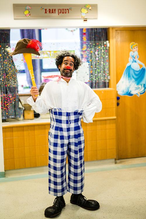 "David ""DuSh"" BarasHi, a medical clown working with ""The Dream Doctors Project"" poses for a portrait, at Hadassah Ein Kerem Hospital in Jerusalem, Israel, on November 9, 2015."