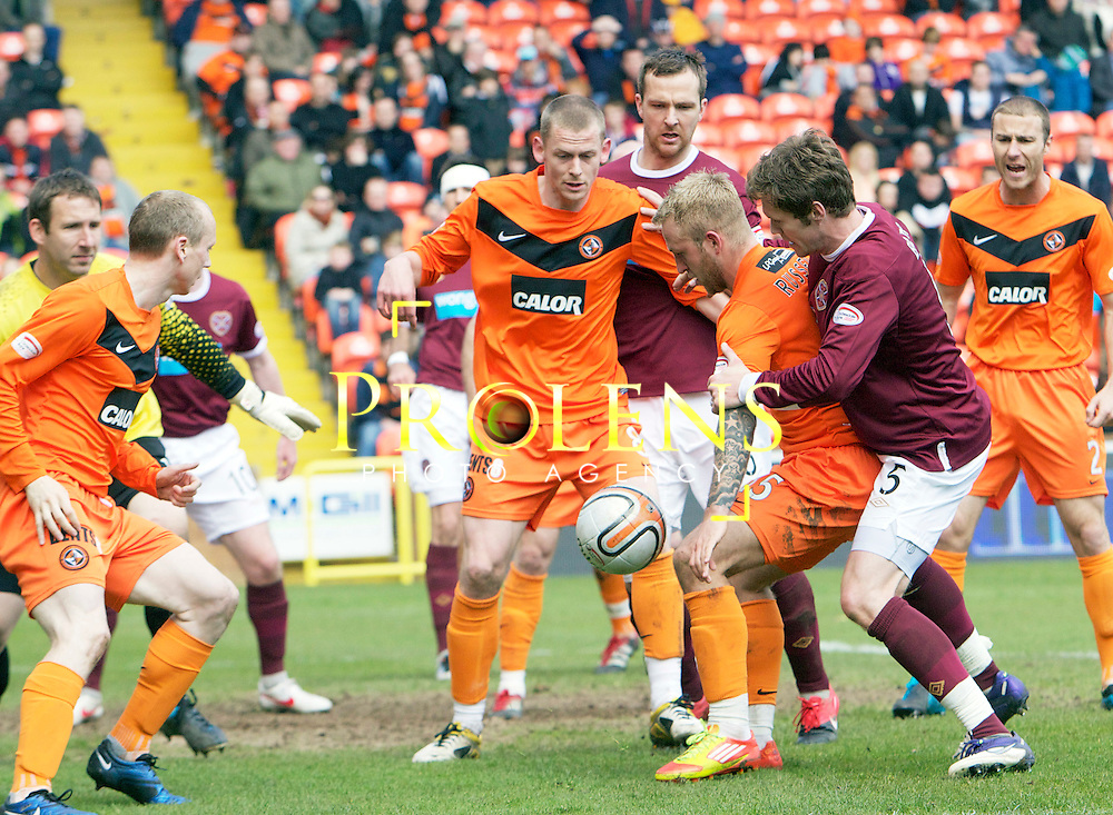 SPL Dundee United FC v  Hearts FC Scottish Premier League Season 2011-12.28-04-12...United's Johnny Russell holds off Hearts Darren Barr      during the Scottish premier League clash between Euro spot chasing Dundee United FC and Heart of Midlothian FC...At Tannadice Stadium, Dundee..Saturday 28th April 2012.Picture Mark Davison/ Prolens Photo Agency / PLPA