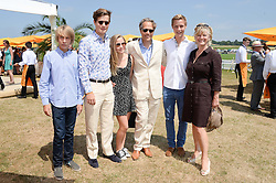 Left to right,the HON.FREDDIE GORDON-LENNOX, LORD SETTRINGTON, LADY ELOISE GORDON-LENNOX, the EARL OF MARCH, WILLIAM GORDON-LENNOX and the COUNTESS OF MARCH at the Veuve Clicquot Gold Cup, Cowdray Park, Midhurst, West Sussex on 21st July 2013.